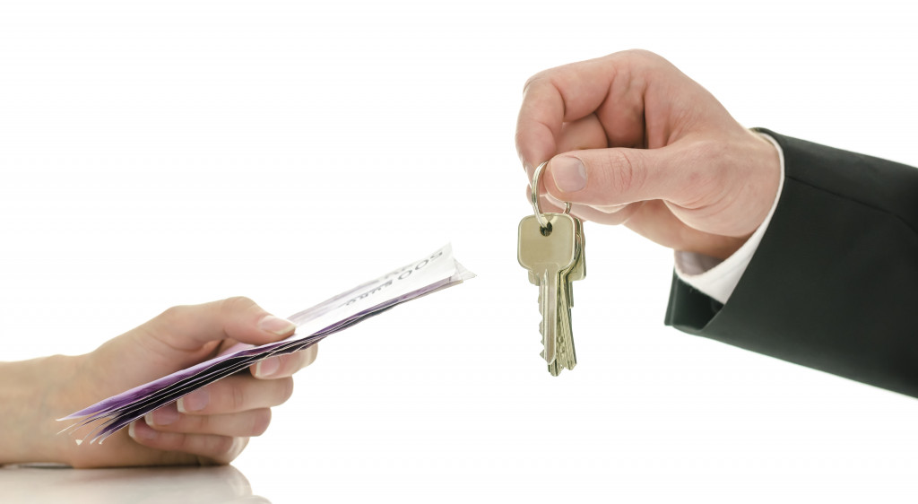 man exchanging money for keys